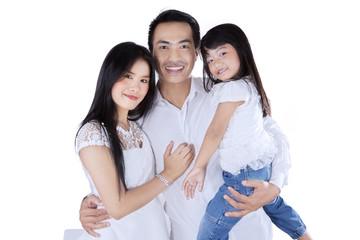 Happy little family in studio
