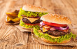 canvas print picture - Fresh hamburgers on wooden planks