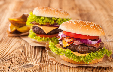 Fresh hamburgers on wooden planks