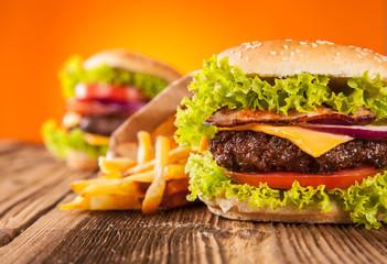Fresh hamburgers on wooden planks