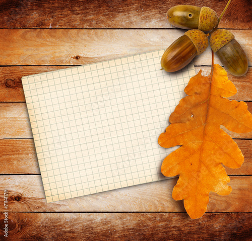 canvas print picture Old grunge paper with autumn oak leaves and acorns on the wooden