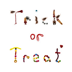 Trick or Treat spelled out in bugs and candy on white background