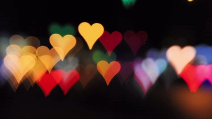 Heart-shaped defocused car lights, city night bokeh