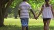 1of18 Black boy, white girl, children holding hands