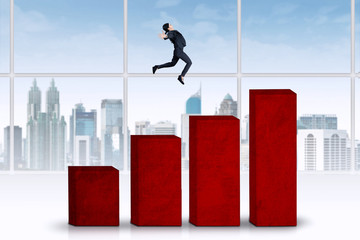 Woman jumps over business graph