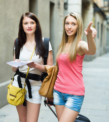 Two beautiful girls with map