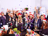 Group people in santa hat at Xmas business party.