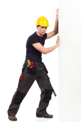 Manual worker pushing the wall