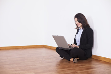 Businesswoman using her laptop