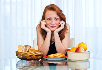 teen girl with freckles at breakfast