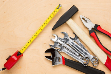 Set of tools on a wood panel