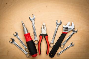 Set of tools on a wood panel
