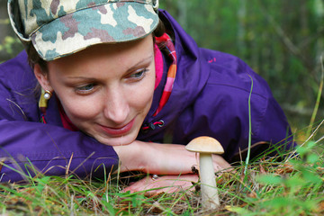 girl collect brown cap boletus on forest