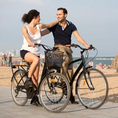 Couple with bikes on a city beach