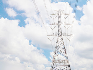 Electric transmission line tower with cloudy sky