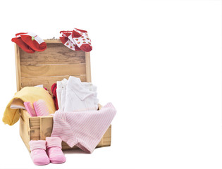 baby clothes on wood box