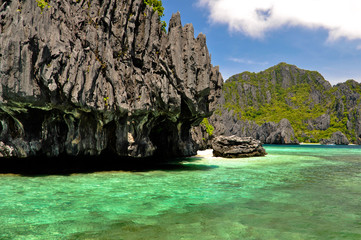 Blue Lagoon Ringed by Jagged Karst Rock Formations