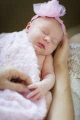 Hands of Mother Holding Her Newborn Baby Girl