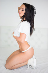 Young Model in White Shirt and Undies Kneeling