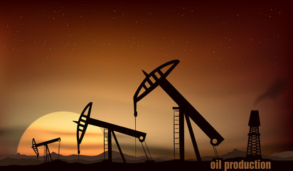 Oil production from the towers at sunset