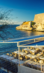 Restaurant tables over beautiful ocean at dusk