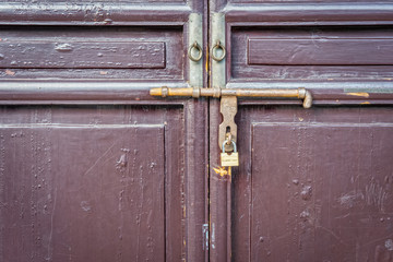 Conceptual image of locked door with old door latch