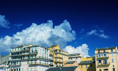 Beautiful town along the ocean with clouds and blue sky on the b