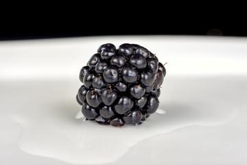 Fresh ripe raw blackberry on a plate