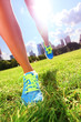 Runner - running shoes on woman athlete