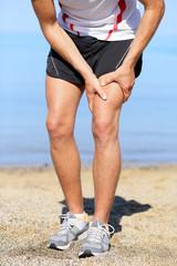 Muscle injury. Man runner sprain thigh muscles
