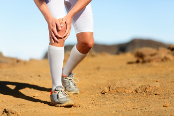 Running injury - Male runner with knee pain