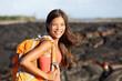 Hiking woman - hiker walking on lava field Hawaii
