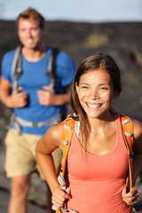 Hiking couple - Asian woman hiker walking on lava