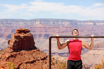 Fitness athlete training pull ups in Grand Canyon