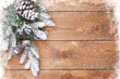 canvas print picture - Old wood texture with snow and firtree