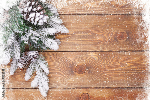 canvas print picture Old wood texture with snow and firtree