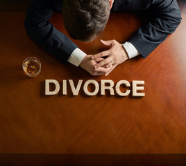 Word Divorce and devastated man composition