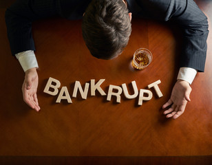 Word Bankrupt and devastated man composition