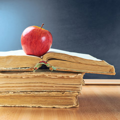 Apple, books and blackboard composition