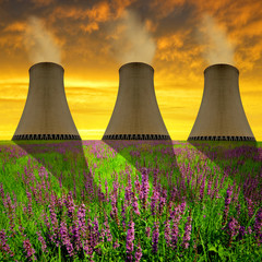 Chimneys of nuclear power plant in sunset