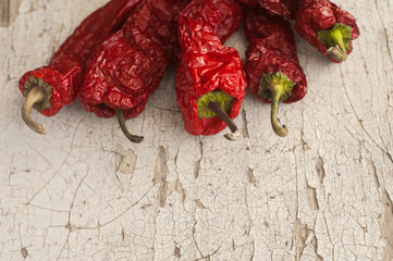 Red Sun-Dried Pepper a basket on wooden table