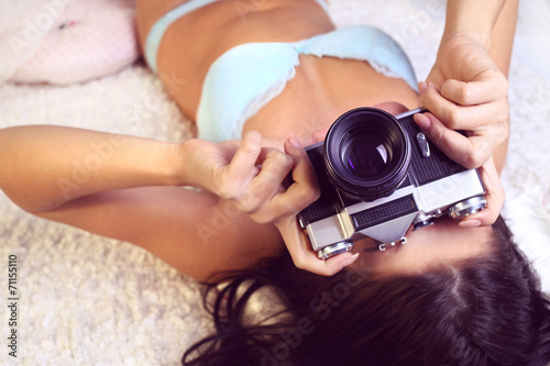 canvas print picture girl in lingerie takes pictures old camera
