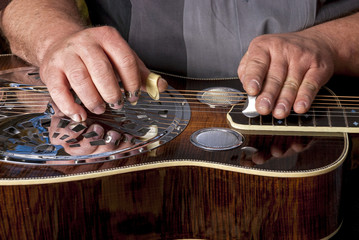 Steel topped Dobro guitar is being played