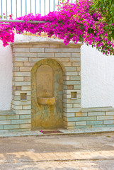 Ancient medieval sandstone drinking fountain, Greece