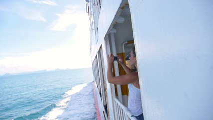 Woman Taking Picture on Cruise Ship with Cellphone. Slow Motion.
