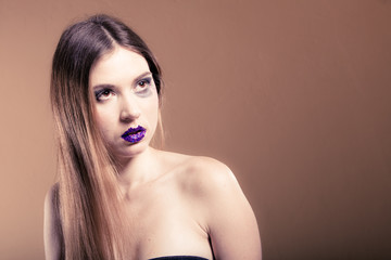 Portrait of girl with long hair and creative makeup