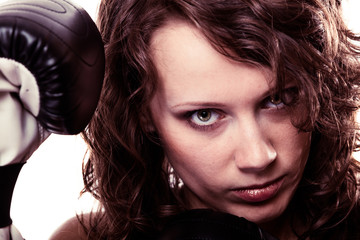 Sport boxer woman in black gloves.