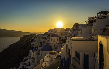 Sunset view of the blue dome churches of Santorini, Greece
