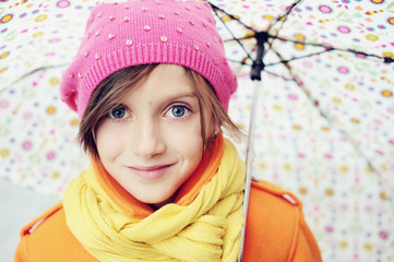 Colorful close up kid girl portrait with umbrella