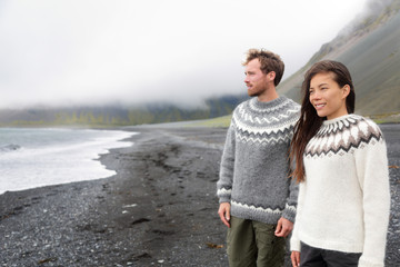 Iceland couple wearing Icelandic sweaters on beach